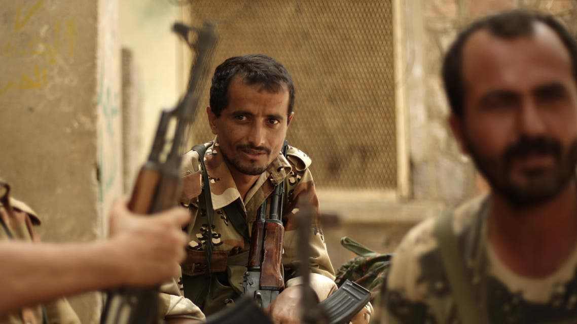 A Yemeni army soldier, center, looks on as he sits with his comrades at their post in the town of Jaar in southern Abyan province, Yemen, Friday, June 15, 2012. Yemen says government troops have killed scores of militants in a push to rout al-Qaida fighters from the last town under militant control in the southern Abyan province. (AP Photo/Hani Mohammed)