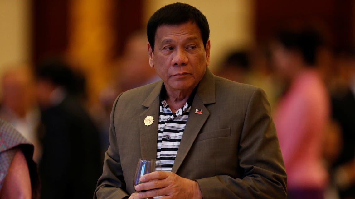Philippine President Rodrigo Duterte attends a welcome dinner at the ASEAN Summit in Vientiane, Laos September 6, 2016. REUTERS/Soe Zeya Tun