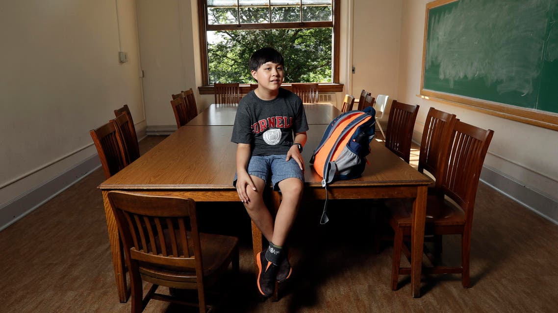 In this Friday, Aug. 26, 2016 photo, Jeremy Shuler, 12, a freshman at Cornell University, poses on campus in Ithaca, N.Y. He's the youngest student on record to attend the Ivy League school. Jeremy's parents, who are both aerospace engineers, moved from Grand Prairie, Texas, to Ithaca, New York, so he could live with them while pursuing his engineering degree. (AP)