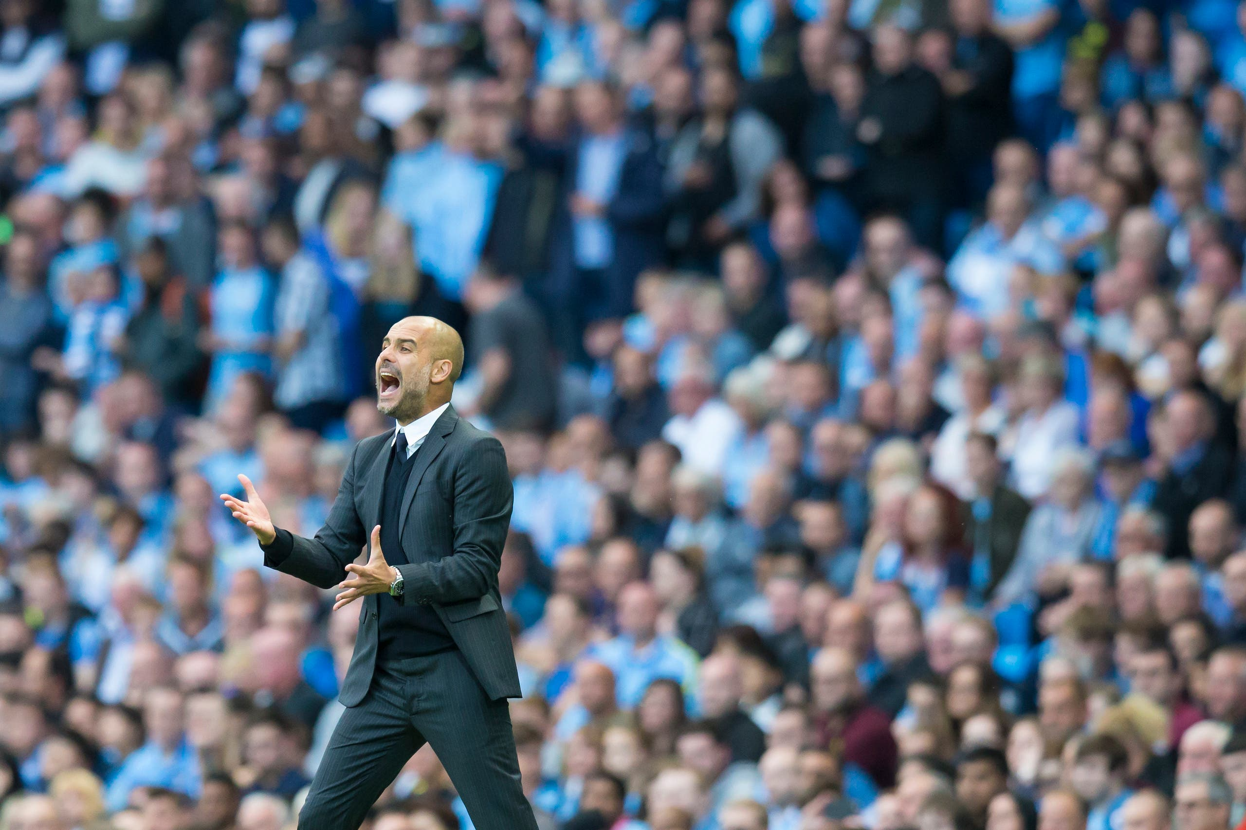 Manchester City's new manager Pep Guardiola reacts after a missed opportunity during the English Premier League soccer match between Manchester City and Sunderland at the Etihad Stadium in Manchester, England, Saturday Aug. 13, 2016. (AP