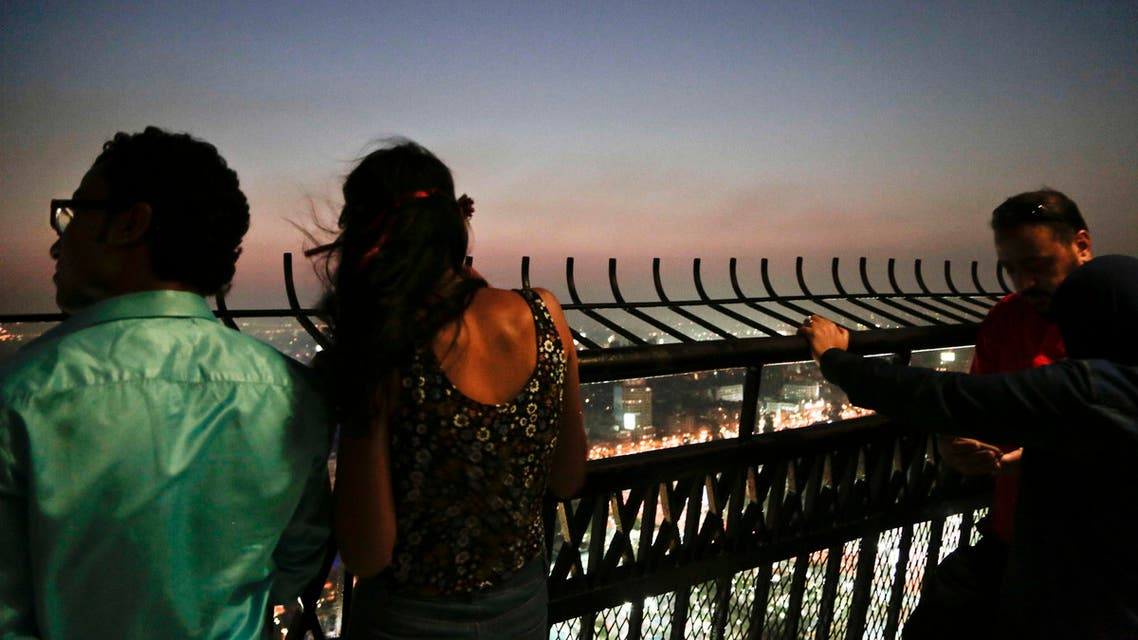 Couples enjoy the view from an observation deck of the Cairo Tower in Egypt, Wednesday, Aug. 17, 2016. (AP)