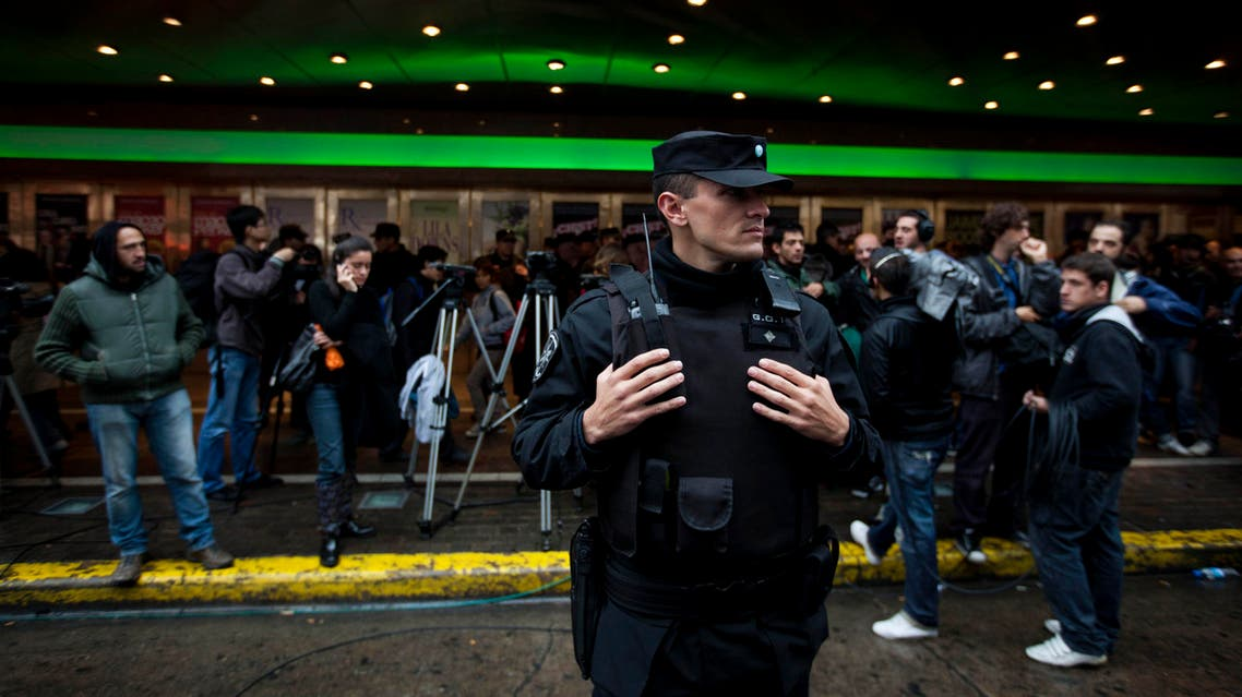 A police officer stands guard outside the Gran Rex theater in Buenos Aires, Argentina, Tuesday, May 22, 2012. Police found a bomb planted in the ceiling of the theater where former Colombian president Alvaro Uribe is scheduled to speak on Wednesday. (AP Photo/Natacha Pisarenko)