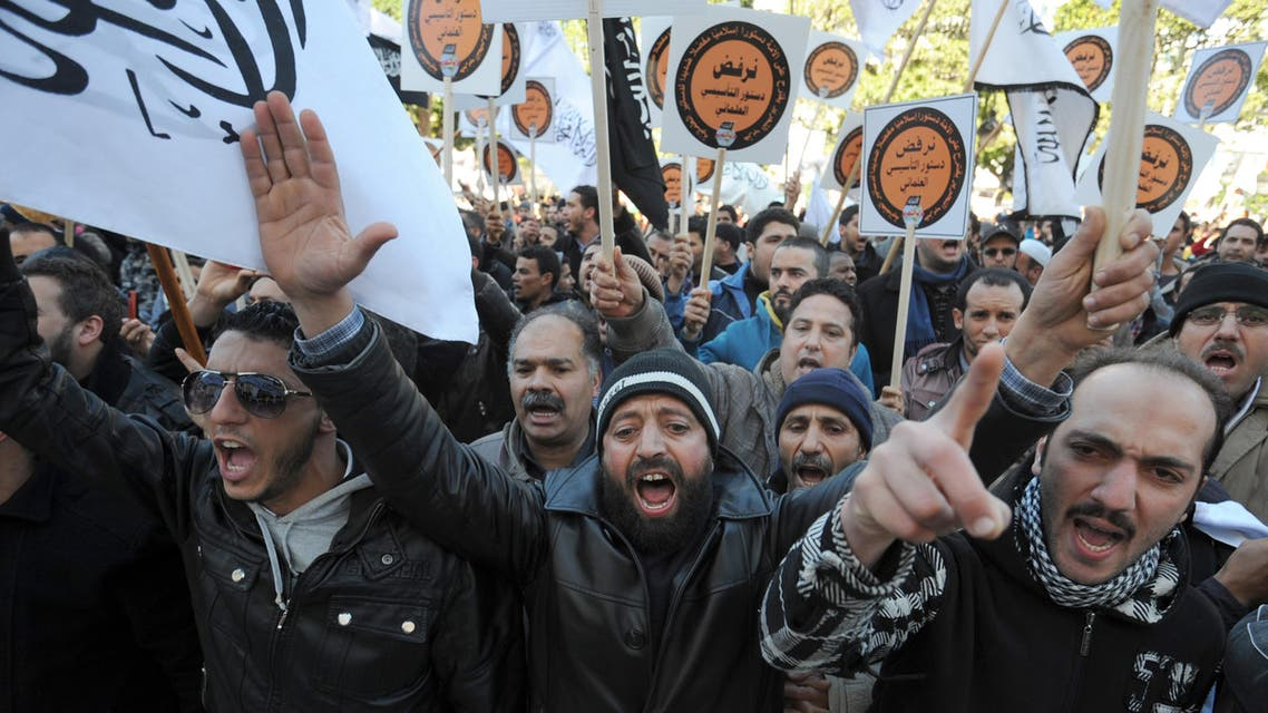 """Tunisian protesters shoot slogans during a demonstration called by the supporters of radical Islamist party Hizb ut-Tahrir to protest against the draft Constitution that they consider """"secular"""" on January 24, 2014 in Habib Bourguiba Avenue in Tunis. (AFP"""