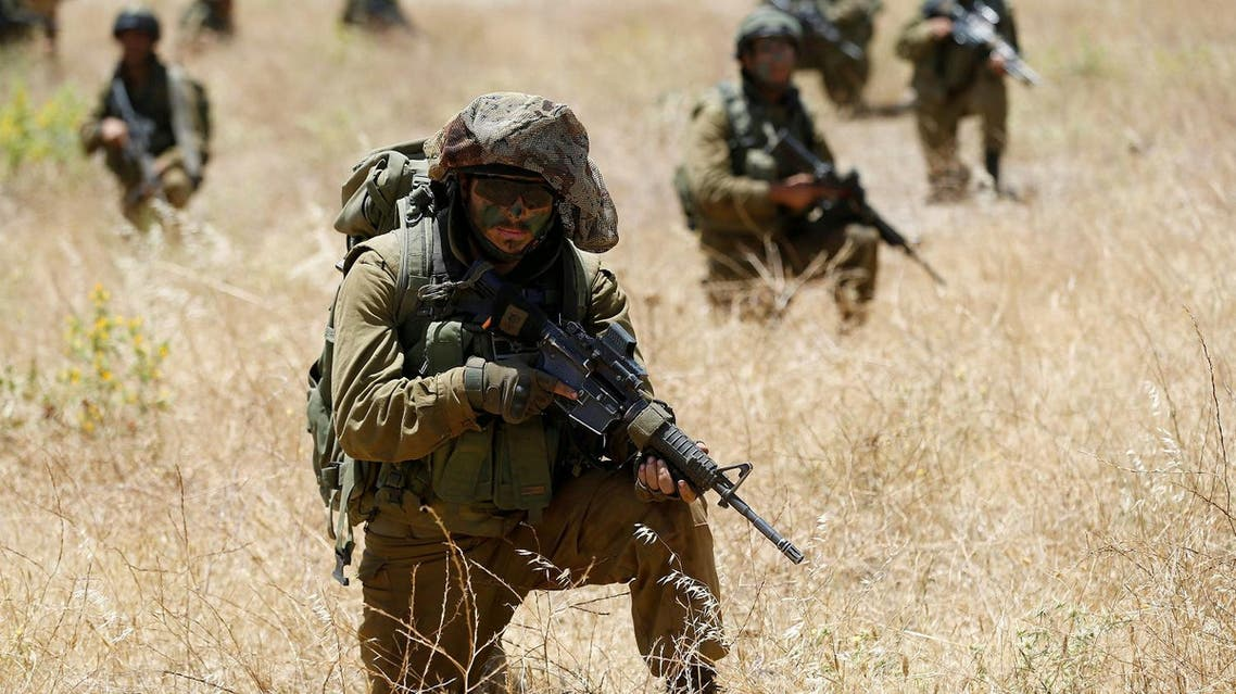 Israeli soldiers from the 605 Combat Engineering Corps battalion take part in a training session on the Israeli side of the border between Syria and the Israeli-occupied Golan Heights June 1, 2016. (Reuters)