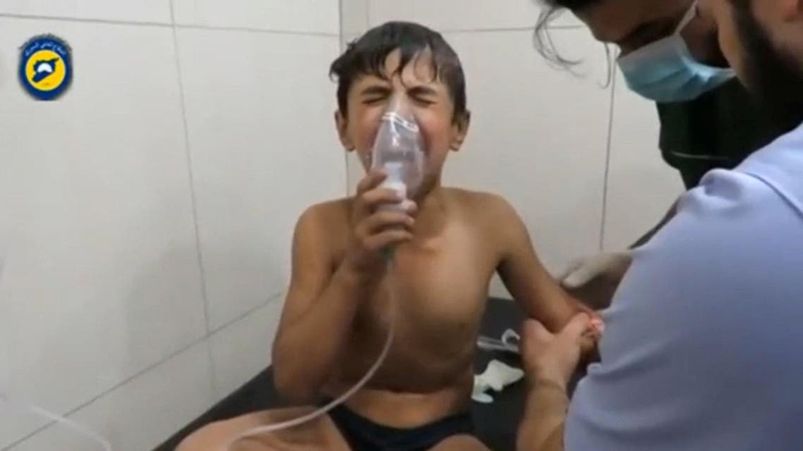 A still image taken on September 7, 2016 from a video posted on social media said to be shot in Aleppo's Al Sukari on September 6, 2016, shows a boy breathing with an oxygen mask inside a hospital, after a suspected chlorine gas attack, Syria. Social Media via Reuters