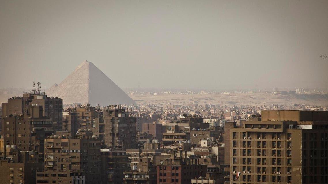 The Giza Pyramids dominate the skyline in Giza, Egypt, Cairo's sister city (Photo: AP)