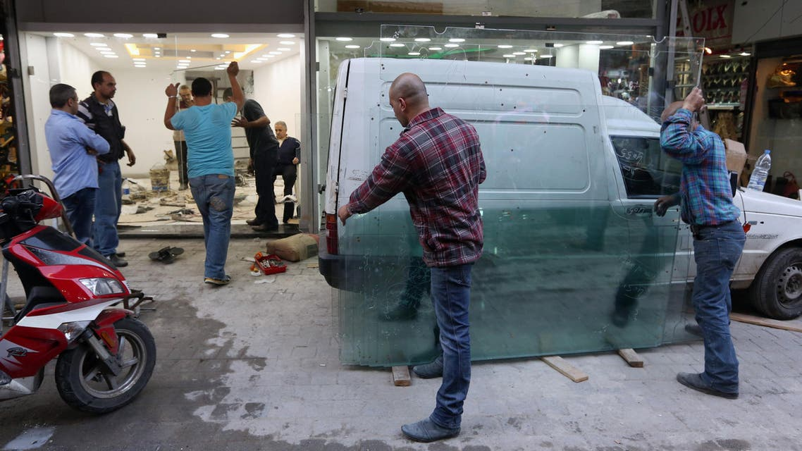 In this file photo of Nov. 20, 2014, Lebanese people reconstruct their shop that was damaged due to clashes between the Lebanese army and militants in the northern port city of Tripoli, Lebanon. (AP)