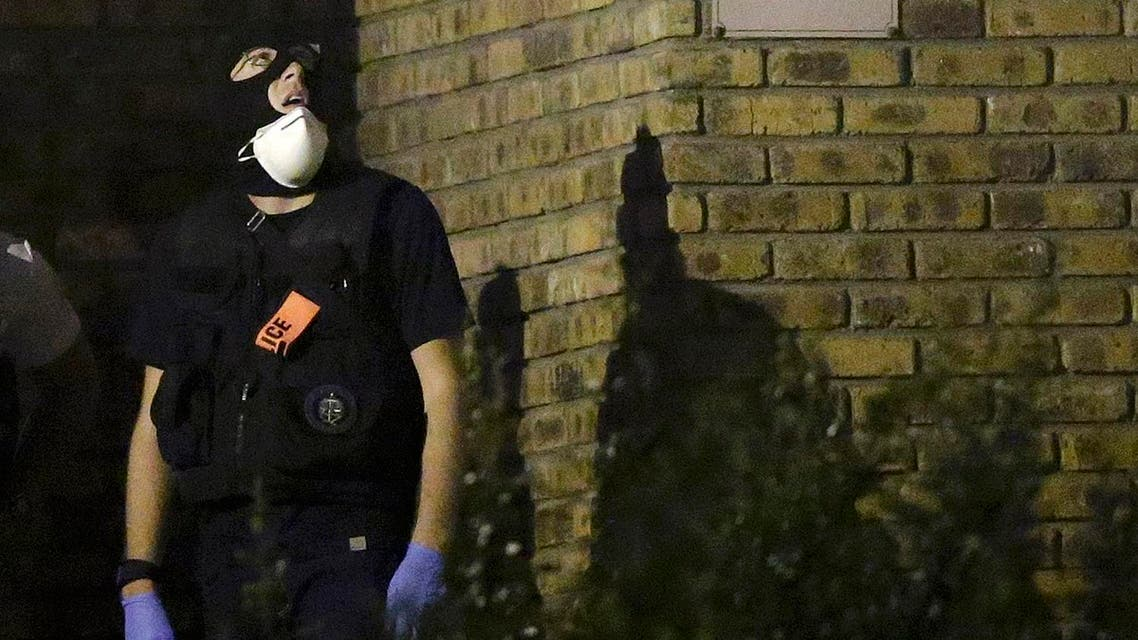 A French policeman takes part in a police raid at a residential buiding in Boussy-Saint-Antoine near Paris. (Reuters)