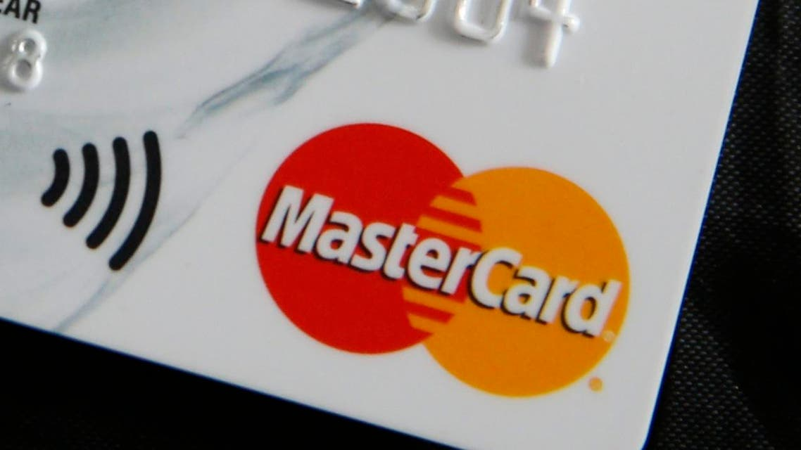 In this photo illustration a detail of a Mastercard credit card showing the logo of the card in London, Friday, Sept. 9, 2016. Britain's former financial services watchdog is suing MasterCard for 14 billion pounds ($18.6 billion), alleging the firm slapped excessive charges on millions of transactions. Law firm Quinn Emanuel filed the suit Thursday at the Competition Appeal Tribunal on behalf of Walter Merricks, a former financial services ombudsman. (AP Photo/Alastair Grant)