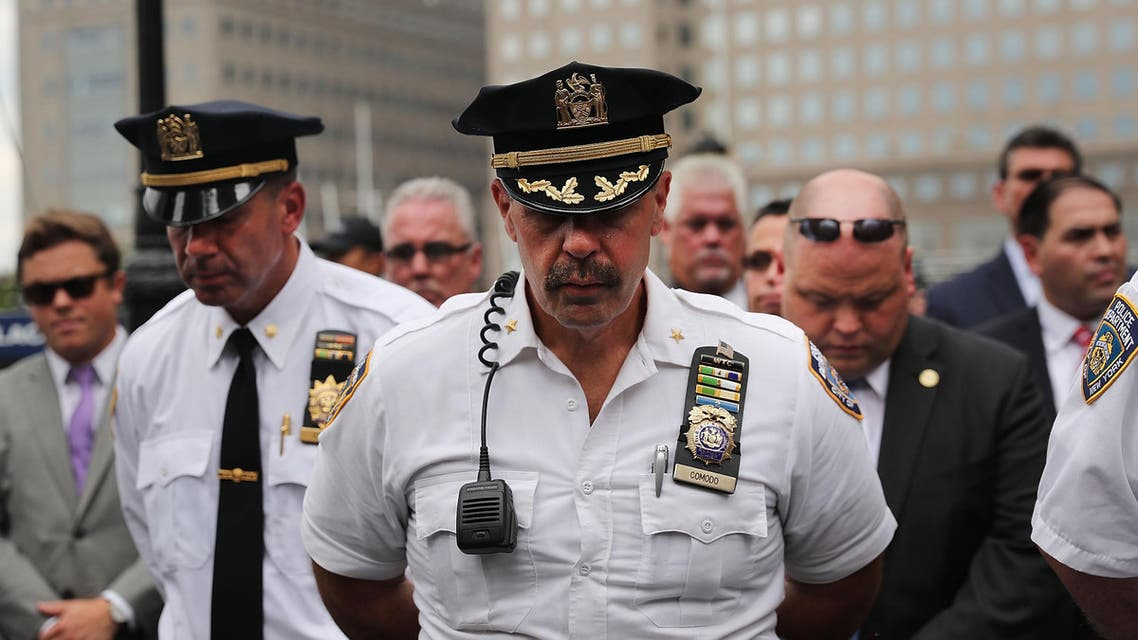 NEW YORK, NY - SEPTEMBER 09: Police pause during a procession in Lower Manhattan to mark the 15th anniversary of the 9/11 attacks and the police officers who were killed during and after the event on September 9, 2016 in New York City. Families, officers and friends gathered for remarks and a wreath laying at a wall commemorating fallen officers. Spencer Platt/Getty Images/AFP