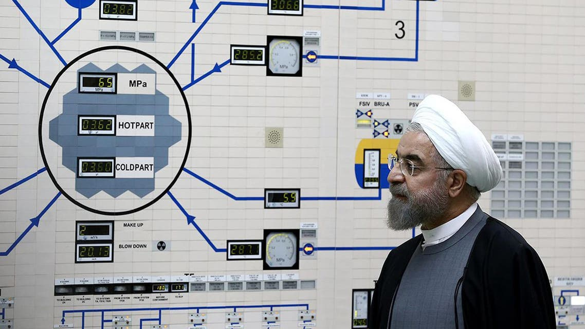 A handout picture released by the official website of the Iranian President Hassan Rowhani, shows him visiting the control room of the Bushehr nuclear power plant in the Gulf port city of Bushehr on January 13, 2015. (AFP)