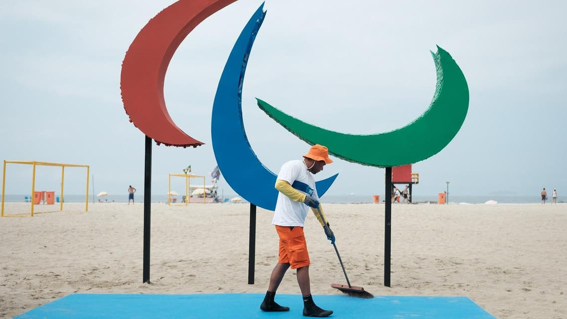 A worker sweeps the area before the inauguration of the symbol of the Rio 2016 Paralympic Games at Copacabana Beach in Rio de Janeiro, Brazil, on September 2, 2016. The sculpture is made out of recycled materials collected at the beach and offers different textures and smells for the interaction with people. YASUYOSHI CHIBA / AFP