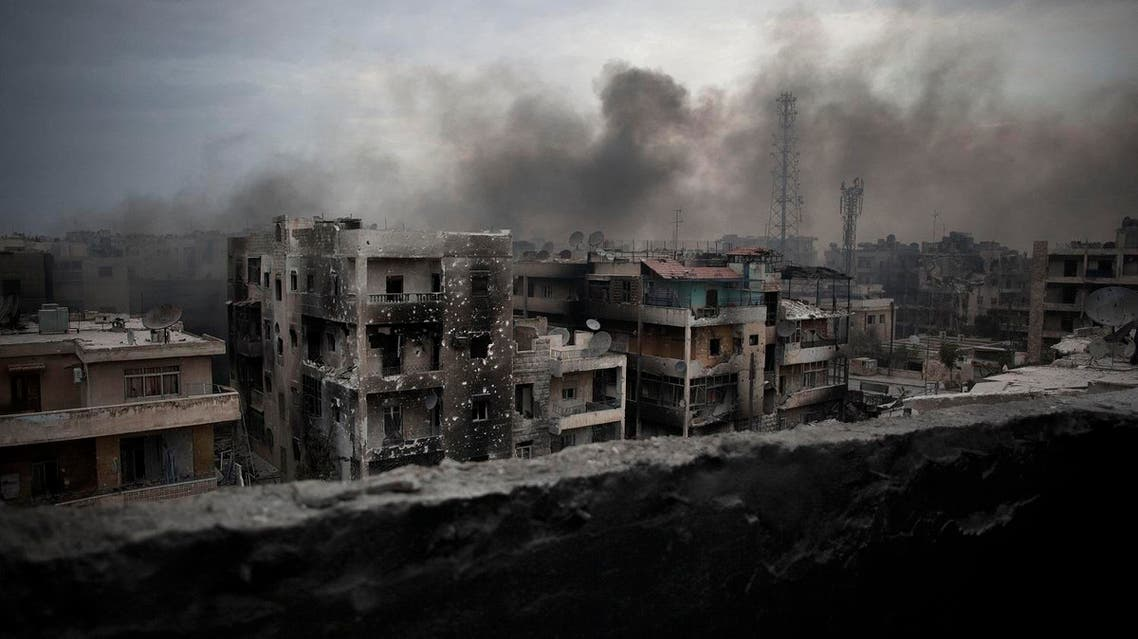 "In this Tuesday, Oct. 2, 2012 file photo, smoke rises over Saif Al Dawla district, in Aleppo, Syria. Asked what he will do about Aleppo's intractable situation, U.S Presidential candidate Gary Johnson responded in earnest: ""What is Aleppo?"" His comments caused a debate in the U.S. about the importance of foreign policy issues in the current presidential elections.(AP Photo/ Manu Brabo, File)"