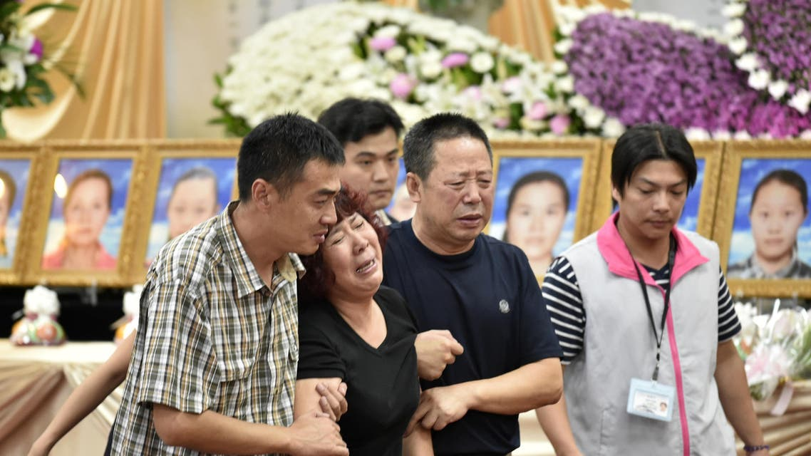 Chinese relatives mourn the loss of victims of a bus crash at Chungli funeral parlour in Taoyuan, northern Taiwan on July 21, 2016. AFP