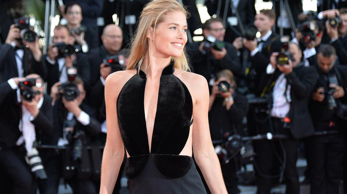 Dutch model Doutzen Kroes poses as she arrives on May 11, 2016 for the opening ceremony for the 69th Cannes Film Festival, southern France (File Photo: AFP)