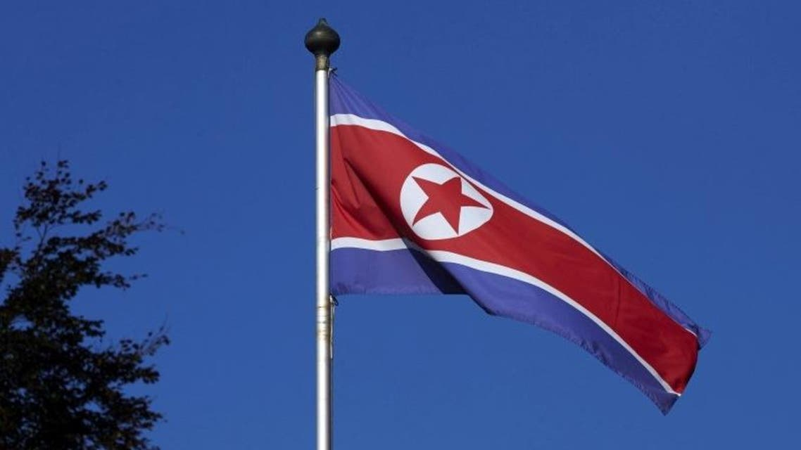 A North Korean flag flies on a mast at the Permanent Mission of North Korea in Geneva October 2, 2014. REUTERS