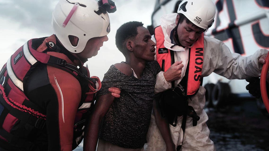 A migrant is helped by rescuers of the vessel Responder, run by the Malta-based NGO Migrant Offshore Aid Station (MOAS) and the Italian Red Cross, at the Mediterranean sea, on Sept. 5, 2016. (AP)