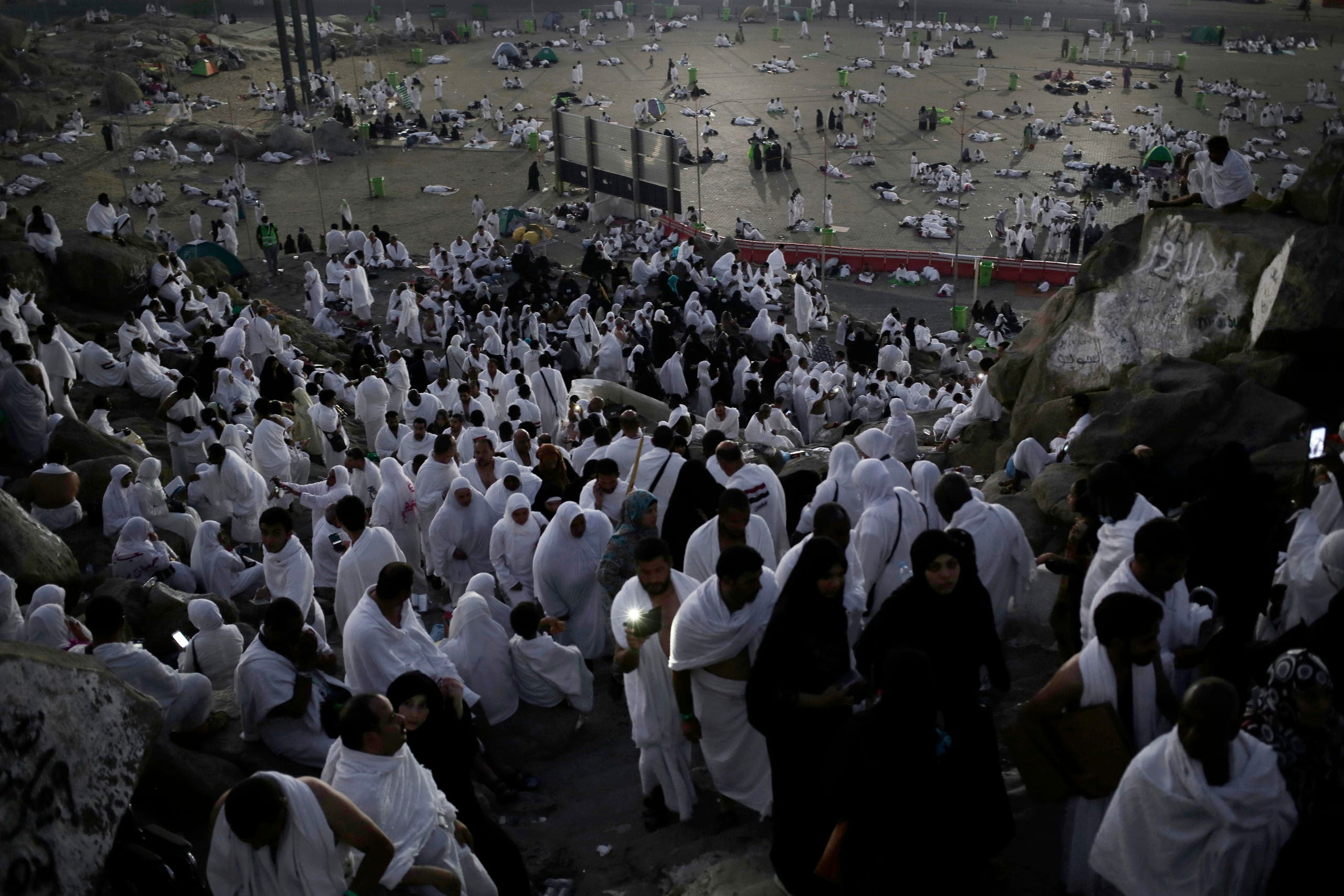 Muslim pilgrims pray on a rocky hill known as Mountain of Mercy, on the Plain of Arafat, during the annual hajj pilgrimage. (AP)