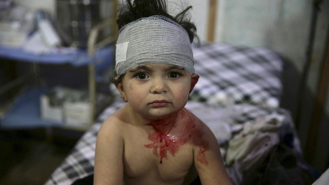 An injured child sits inside a field hospital, after what activists said was shelling by forces loyal to Syria's President Bashar al-Assad, in the Douma neighborhood of Damascus, Syria. REUTERS/Bassam Khabieh