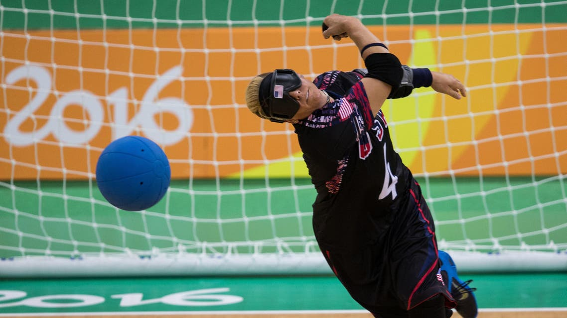 In this photo provided by the IOC, Asya Miller, of the United States, takes a shot in a Goalball women's preliminary Group C match against Brazil during the Paralympic Games at the Future Arena, in Rio de Janeiro, Brazil, Thursday, Sept. 8, 2016. AP