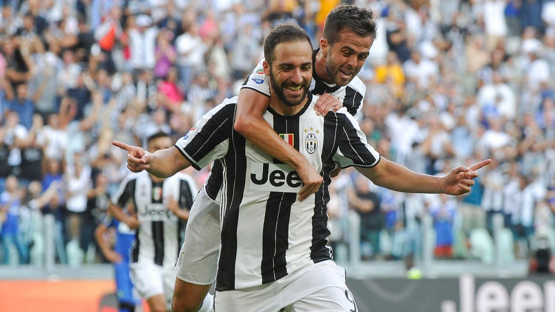 Juventus' Gonzalo Higuain celebrates with teamate Miralem Pjanic after scoring against Sassuolo. REUTERS