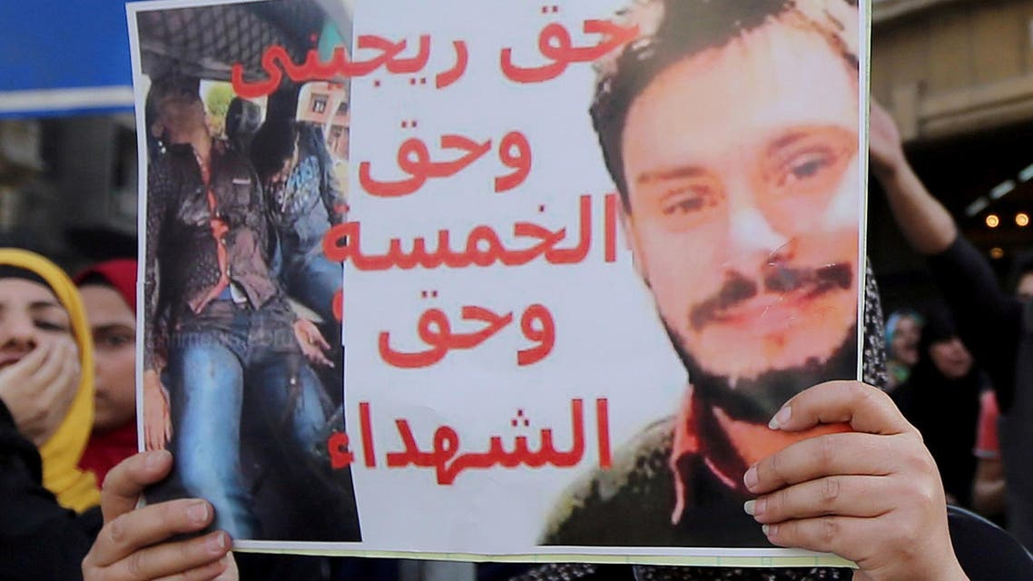 An Egyptian activist holds a poster calling for justice to be done in the case of the recently murdered Italian student Giulio Regeni during a demonstration protesting the government's decision to transfer two Red Sea islands to Saudi Arabia, in front of the Press Syndicate in Cairo, Egypt, April 15, 2016. (Reuters)