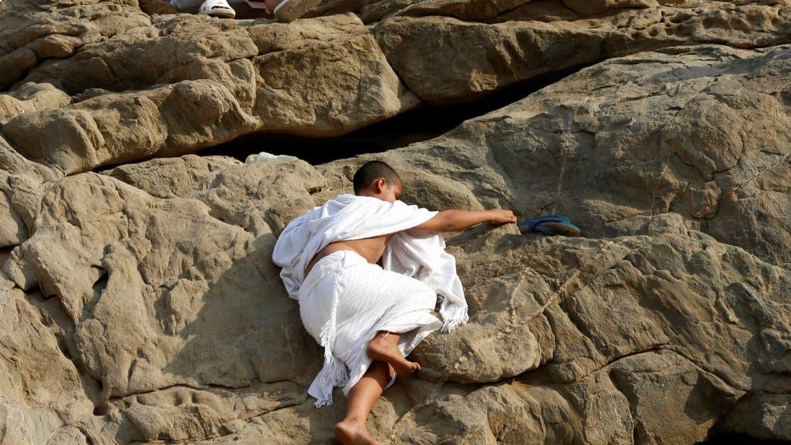 Pilgrims ascend Mount Arafat for Hajj climax