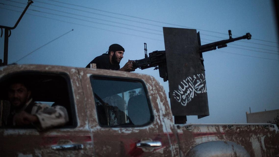A member of the Islamist Syrian opposition group Ahrar al-Sham fires against a position of the Committees for the Protection of the Kurdish People (YPG). (File photo: AFP)