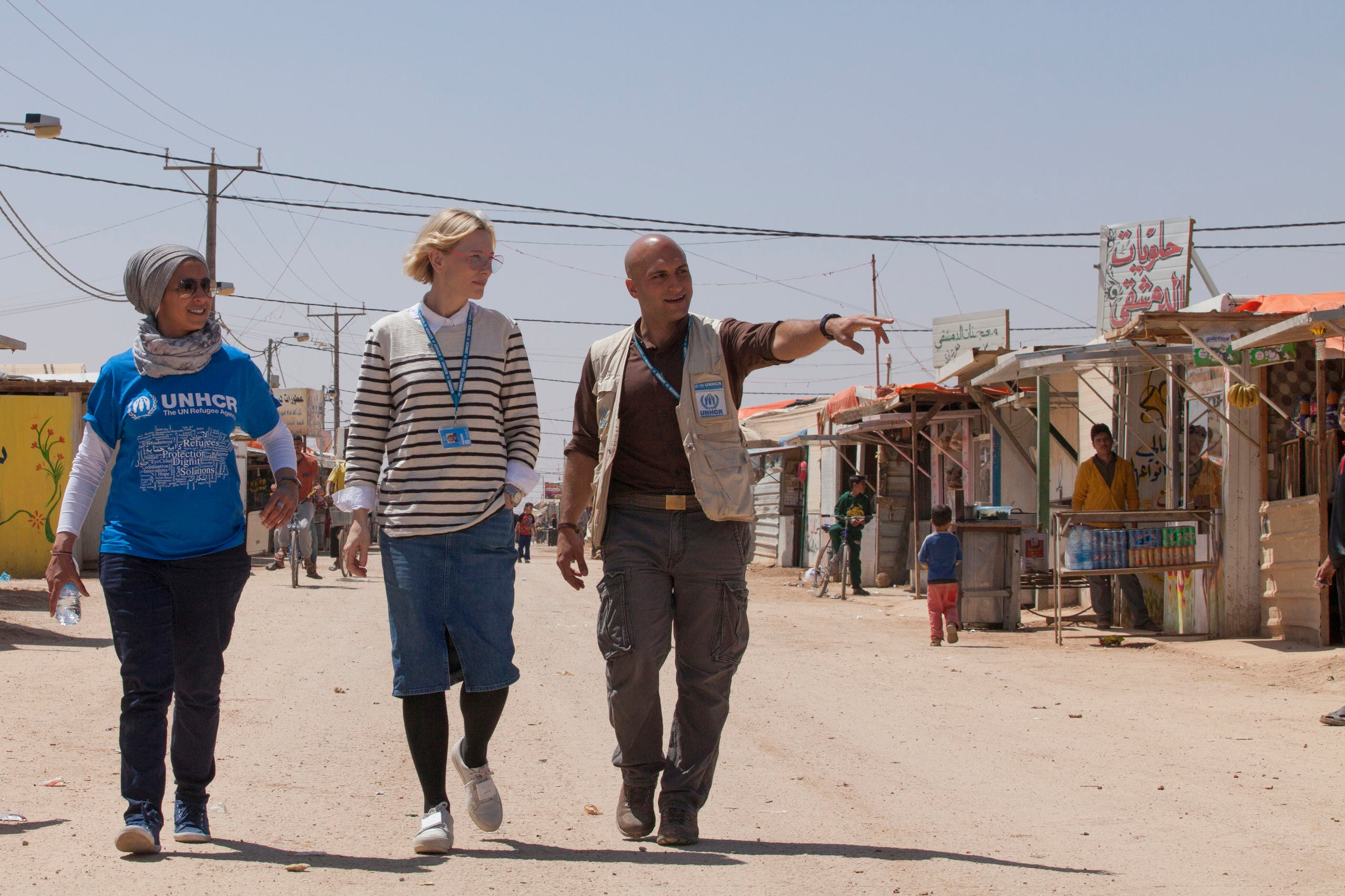 In this undated handout photo released by UNHCR on Monday, Sept 12 2016, UNHCR goodwill ambassador Cate Blanchett, center, and camp manager Hovig Etyemezian, right, walk at Zaatari refugee camp as they visit Syrian refugees in Jordan. ap