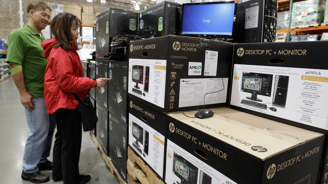 Shoppers look at Hewlett-Packard Company printers, monitors and computers at Costco in Mountain View, California. (AP)