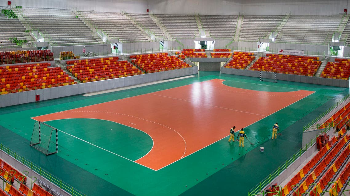 This April 4, 2016 file photo shows workers cleaning the Future Arena during a foreign media tour at Olympic Park in Rio de Janeiro, Brazil, which will host Olympic handball games and Paralympic goalball. aP