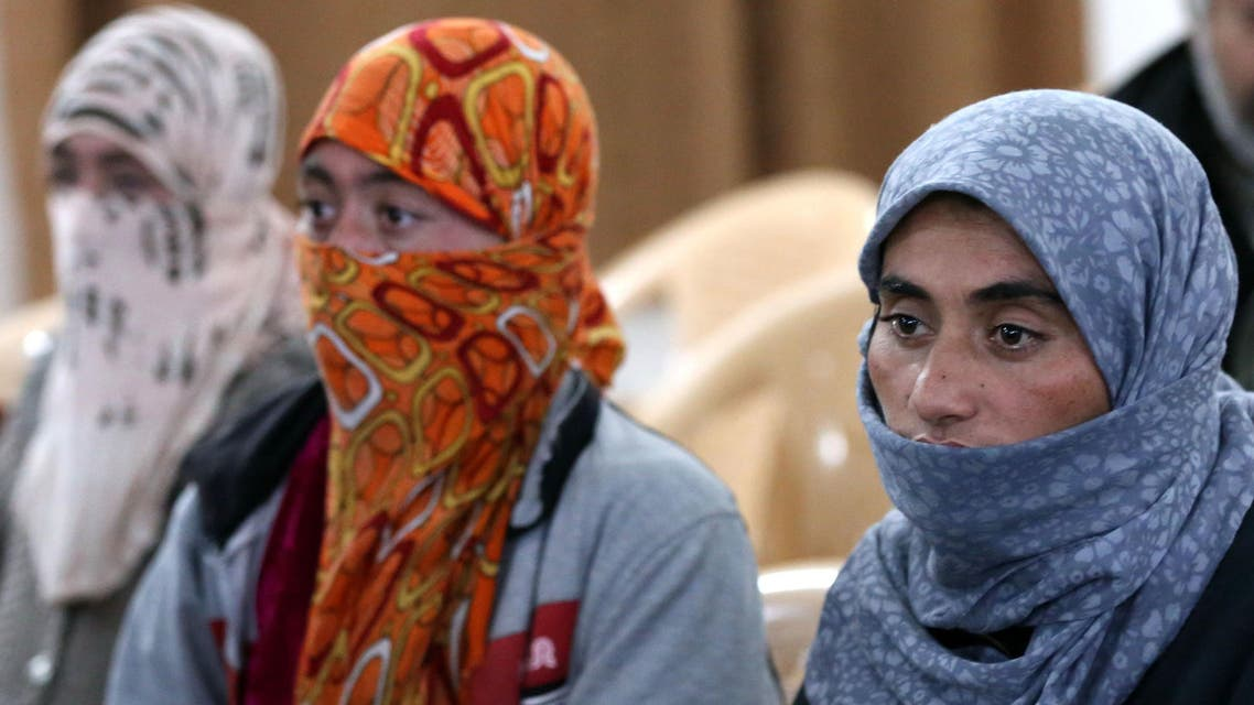 Yazidi women look on at Al-Tun Kopri health centre, located half way between the northern Iraqi city of Kirkuk and Arbil, after they were released with around 200 mostly elderly members of Iraq's Yazidi minority near Kirkuk on January 17, 2015 after being held by the Islamic State jihadist group for more than five months. Medical teams from the Kurdistan Regional Government carried out blood tests and provided emergency care to the group of Yazidis, many of whom looked sick and distraught. Yazidi officials and rights activists say thousands of members of their Kurdish-speaking community are still in captivity. AFP