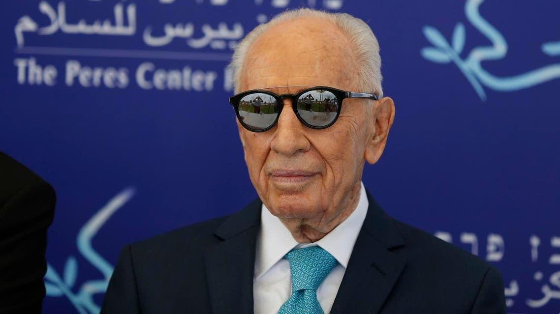 """This file photo taken on May 9, 2016 shows former Israeli president Shimon Peres during the opening of the """"Mini World Cup for Peace"""" football event at the Herzlyia stadium, in the Israeli city of Herzlyia near Tel Aviv (File Photo: Ahmad Gharabli/AFP)"""