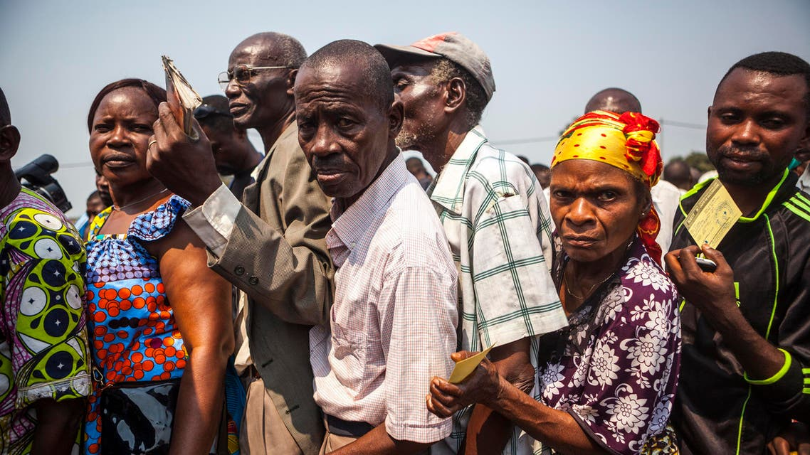 People wait in line to get a yellow fever vaccine during a ceremony launching a response campaign against yellow fever in the district of Kisenso, Kinshasa, on July 20, 2016.