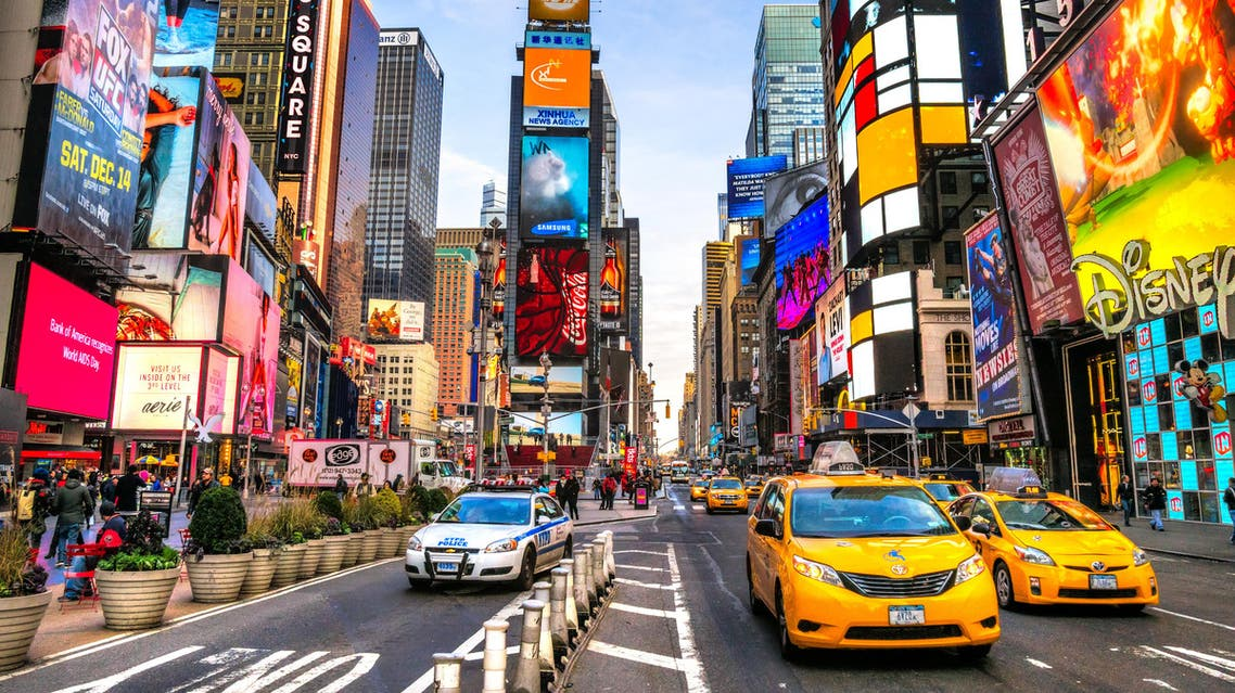 Times Square ,is a busy tourist intersection of neon art and commerce and is an iconic street of New York City and America, December 01th, 2013 in Manhattan, New York City. shutterstock