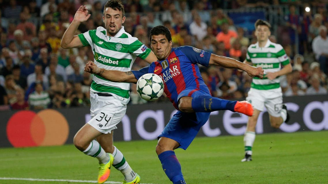 Barcelona's Luis Suarez shoots to score his side's 6th goal during a Champions League, Group C soccer match between Barcelona and Celtic, at the Camp Nou stadium in Barcelona, Spain, Tuesday, Sept. 13, 2016. (AP