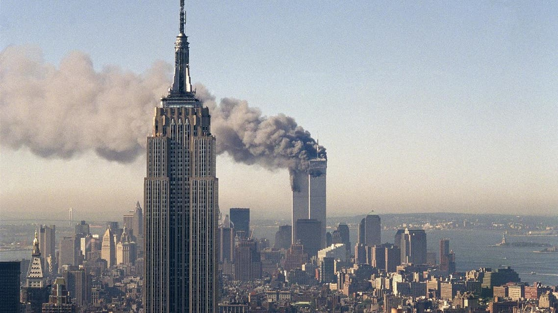 In this Sept. 11, 2001 file photo the twin towers of the World Trade Center burn behind the Empire State Building in New York after terrorists crashed two planes into the towers causing both to collapse (File Photo: AP/Marty Lederhandler)
