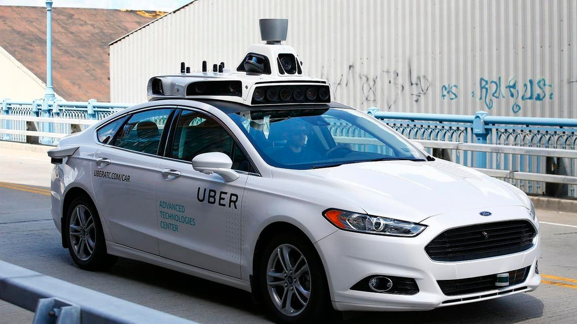 The introduction of driverless cars challenges Uber as an app-based service that gave millions of car owners around the world the chance to make money without taxicab licenses. (AP)