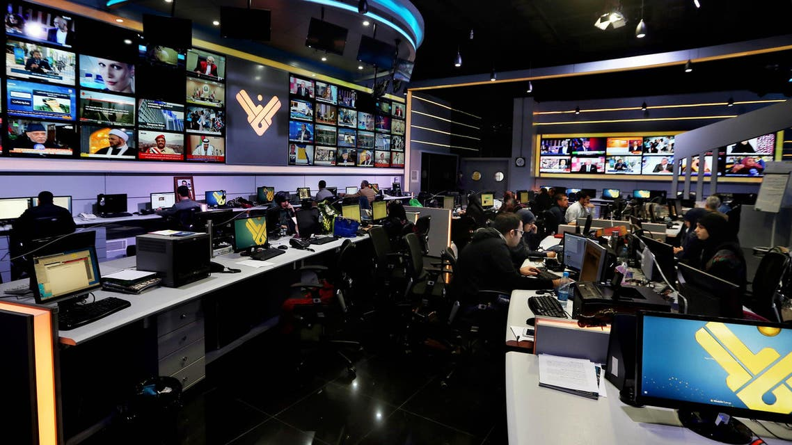 Employees work in the newsroom of Hezbollah's Al-Manar TV station, in the southern suburb of Beirut, Lebanon, Thursday, Dec. 10, 2015. Hezbollah's Al-Manar TV station has vowed to continue broadcasting after it was abruptly dropped by one of the Middle East's main satellite operators. (AP)