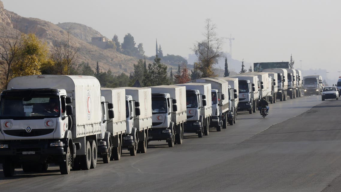 The convoys, each of around 20 trucks carrying mostly food and flour, set off from the Turkish border town of Cilvegozu. (AP)