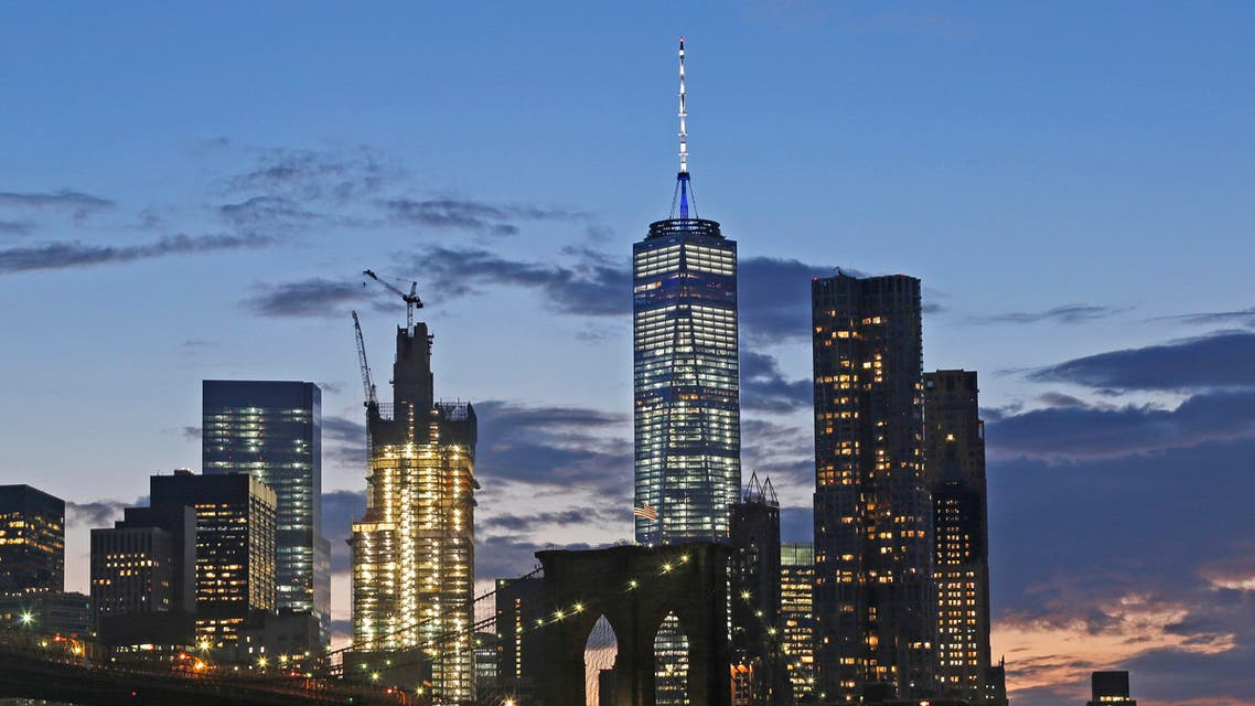 In this Aug. 19, 2016 photo, the lower Manhattan skyline, including One World Trade Center and the Brooklyn Bridge, are shown in New York. AP