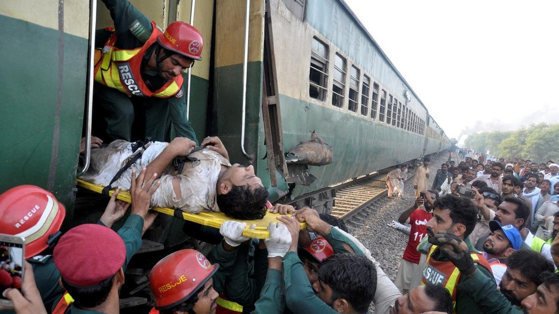 Rescue workers pass a strecher with an injured passenger out of the wreckage after two trains collided near Multan. (Reuters)