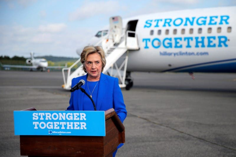 Hillary Clinton holds a news conference on the airport tarmac in front of her campaign plane in White Plains. (Reuters)