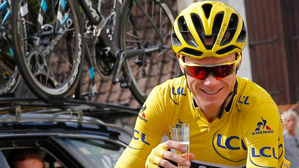 his is a Sunday, July 24, 2016 file photo of Britain's Chris Froome, wearing the overall leader's yellow jersey, celebrates with a glass of champagne during the twenty-first stage of the Tour de France in Paris. AP