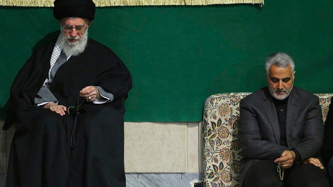 In Friday, March 27, 2015 file this photo released by an official website of the office of the Iranian supreme leader, commander of Iran's Quds Force, Qassem Soleimani, right, sits next to the Supreme Leader Ayatollah Ali Khamenei while attending a religious ceremony in a mosque at his residence in Tehran, Iran. The tide of global rage against the Islamic State group lends greater urgency to ending the jihadis' ability to operate at will from a base in war-torn Syria. Iran has sent more advisers into Syria in recent weeks, as well as reportedly dispatching again Gen. Qassem Soleimani. (AP Photo/Office of the Iranian Supreme Leader, File)