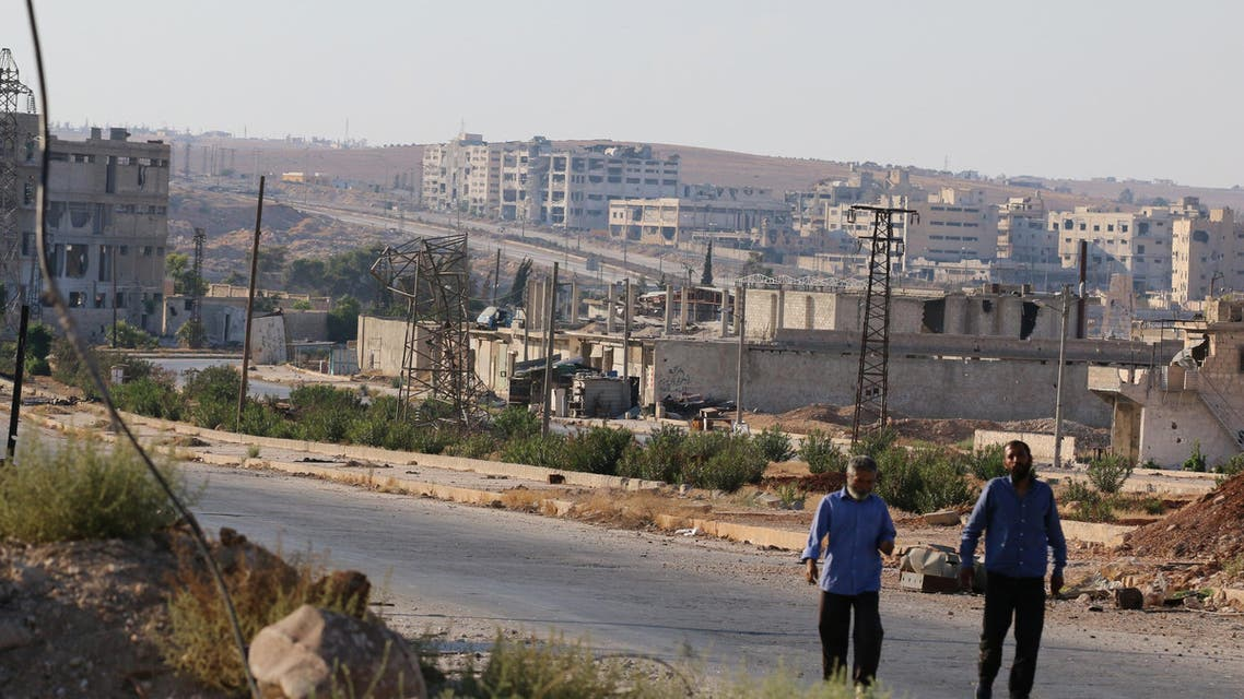 People walk near Castello road (background) in Aleppo, Syria, September 14, 2016. reuters