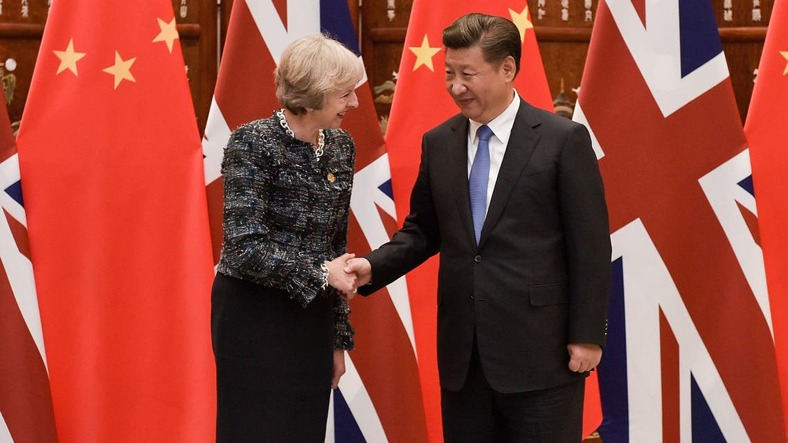 Chinese President Xi Jinping, right, shakes hand with British Prime Minister Theresa May, prior to their meeting, at the West Lake State House, in Hangzhou, China.,  Sept. 5, 2016. AP