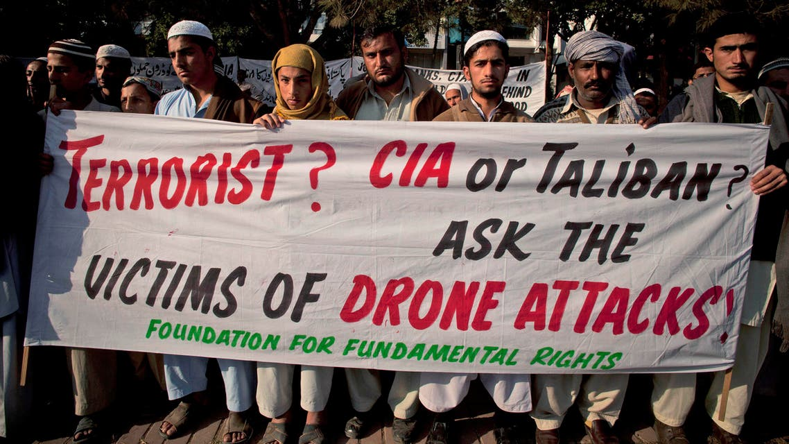 In this Friday, Dec. 10, 2010 file photo, Pakistani tribal villagers hold a rally to condemn U. S. drone attacks on their villages in border areas along the Afghanistan border, in Islamabad, Pakistan. AP