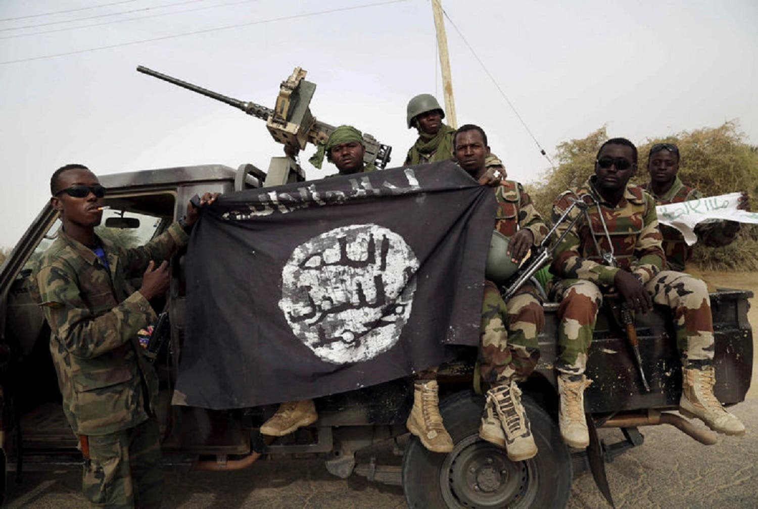 Nigerian soldiers hold up a Boko Haram flag that they had seized. (File Photo: Reuters)