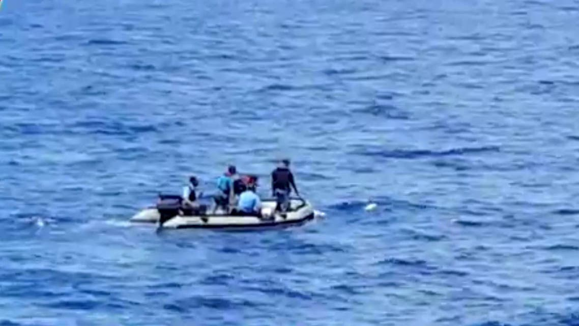 This still image taken from video posted Saturday, May 21, 2016, on the official Facebook page of the Egyptian Armed Forces spokesman shows an Egyptian dinghy collecting wreckage of EgyptAir flight 804. AP